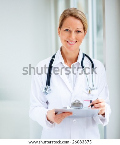 stock photo : Portrait of successful cute mature female doctor holding a ...