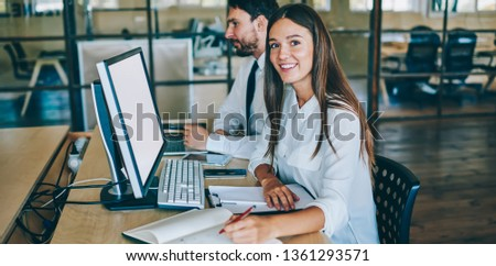 Portrait of successful female coworker looking at camera during break of searching information about finance news in world via modern computer with blank screen for your internet advertising #1361293571
