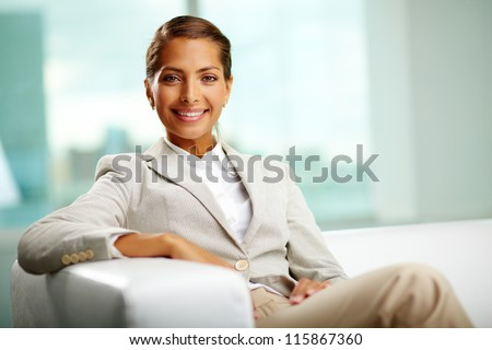 Portrait of successful female sitting in office