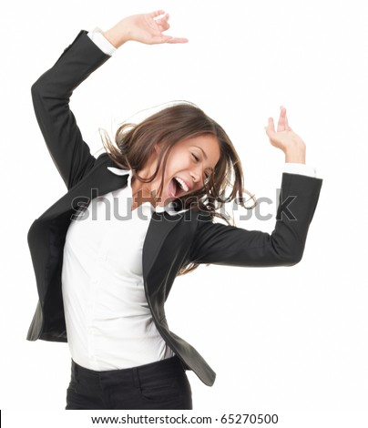 Portrait of successful winner celebrating by dancing. Beautiful young happy woman isolated on white background.