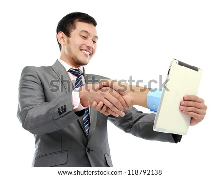 portrait of successful young business man dealing business from tablet PC