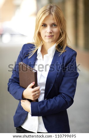 Portrait of Successful young business woman with modern tablet PC