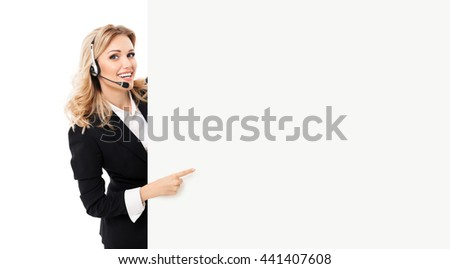 Portrait of support phone operator in headset showing blank signboard with copyspace area for text or slogan, isolated against white background #441407608