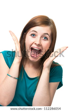 Portrait of surprised beautiful girl in casual wear
