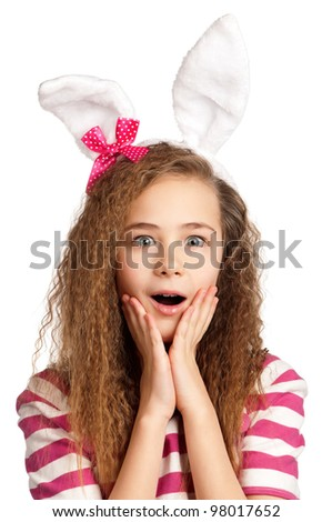 Portrait of surprised girl with bunny ears isolated on white background