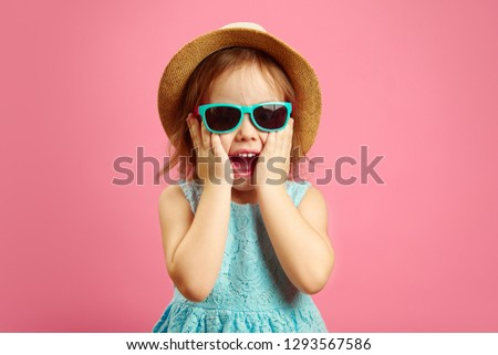 Portrait of surprised girl with open moutn, wears in panama hat and sunglasses, expresses surprise and delight, stands over pink isolated background. #1293567586