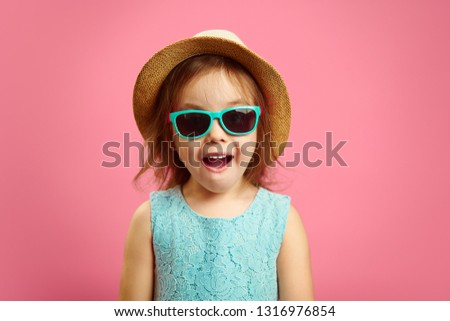 Portrait of surprised girl with open moutn, wears in panama hat and sunglasses, expresses surprise and delight, stands over pink isolated background. #1316976854