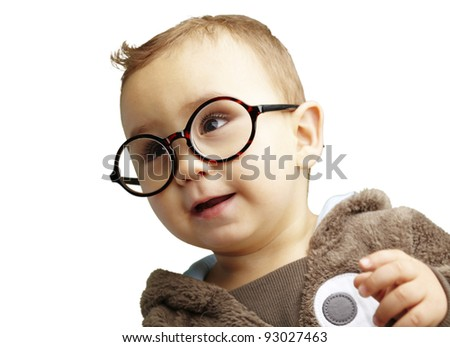 portrait of sweet kid wearing round glasses over white background