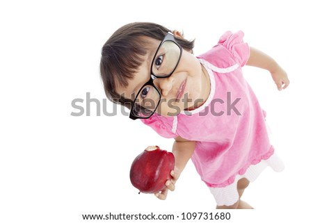 Portrait of sweet little female kindergarten pupil holding red apple. isolated on white background