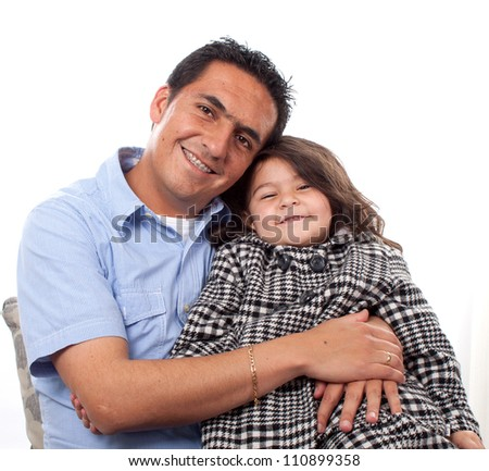 Portrait of sweet young girl with her father at home