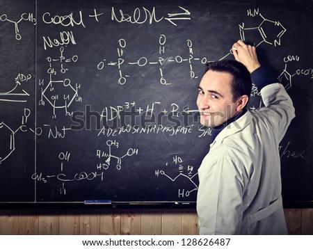 portrait of teacher with blackboard background