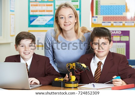 Portrait Of Teacher With Pupils In Science Lesson Studying Robotics #724852309