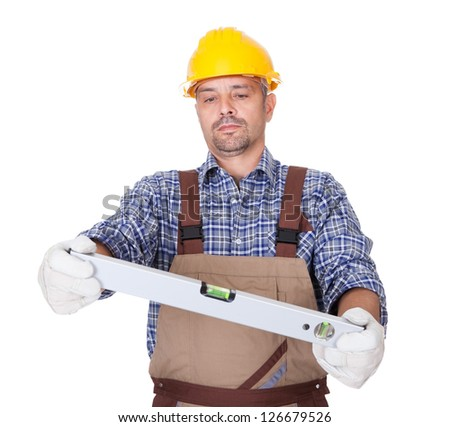 Portrait Of Technician Looking At Level Isolated On White Background