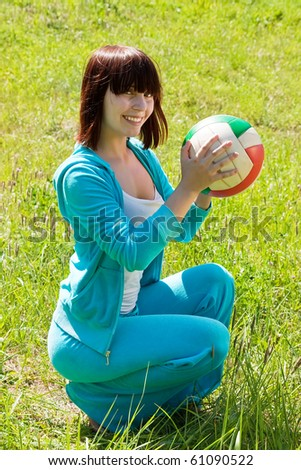 Portrait of teen athlete with volleyball in a summer park