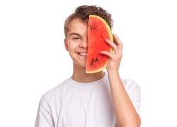 Portrait of teen boy eating ripe juicy watermelon and smiling. Cute caucasian young teenager, isolated on white background. Funny happy child covered his face with slice red watermelon.