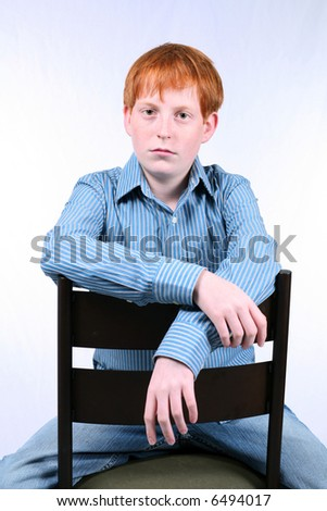 stock photo : portrait of teen boy with red hair and freckles