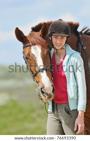 Portrait of teen-girl and her horse