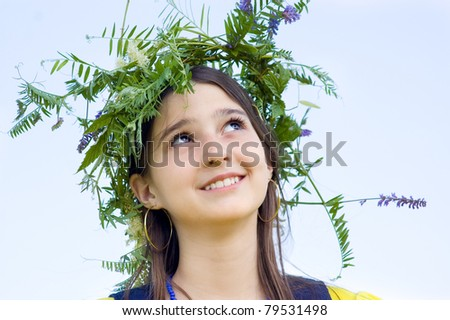 Portrait of teen girl wearing a crown of flowers - stock photo