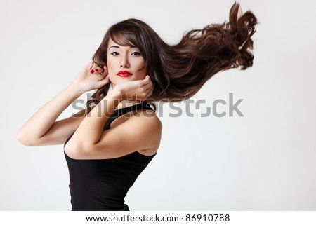 portrait of teen girl with beautiful long brown healthy hair and vivid makeup