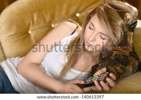 portrait of teen girls resting on sofa at home