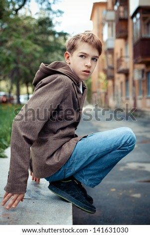 Portrait of teen on background of city.