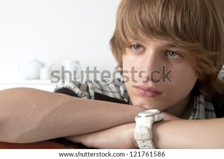 Portrait of Teenage Boy putting his hands on the guitar Looking thoughtfull