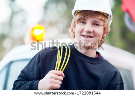 Portrait of teenage electrician student wearing hardhat