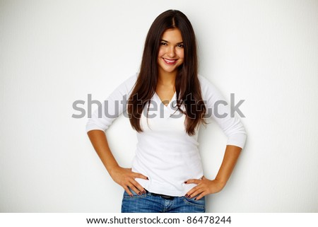 Portrait of teenage girl standing by the wall