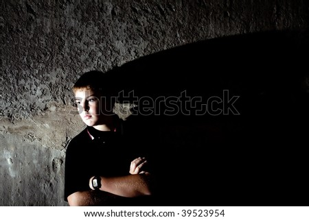 Portrait of teenager against in profile against concrete wall high contrast checkout more of same model