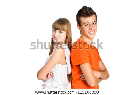 portrait of teenager boy and girl smiling isolated over white background