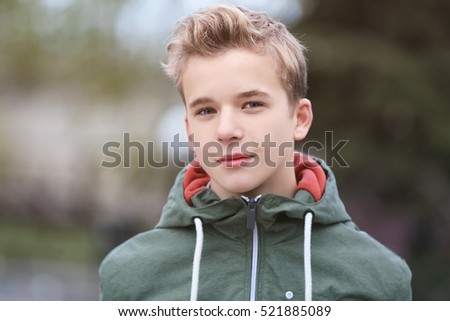 Portrait of teenager outdoors on blurred background, closeup