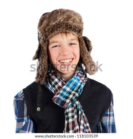 Portrait of teenager wearing fur hat, isolation