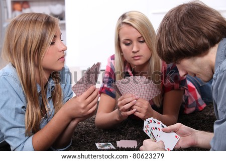portrait of teenagers playing cards