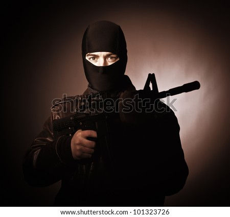 portrait of terrorist with automatic rifle