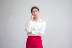 Portrait of thai adult working women white shirt red skirt think