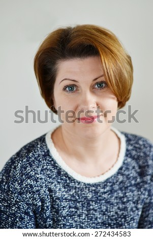 Portrait of the adult female on a light background #272434583