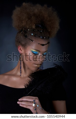 Portrait of the african model with feather