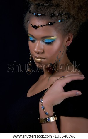 Portrait of the african model with with colorful tribal make-up