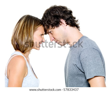 Portrait of the angry young couple  isolated over white background