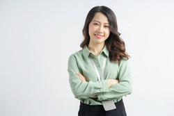 Portrait of the beautiful asian businesswoman with arms crossed on a white background