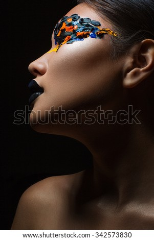 Stock Photo Portrait of the beautiful asian girl with creative art makeup with bright colors