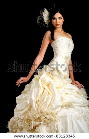 Portrait of the beautiful bride in wedding dress on a dark background