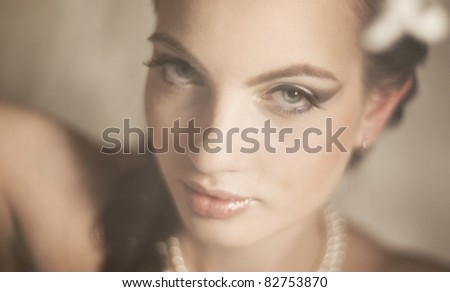 Portrait of the beautiful girl of the bride with soft light