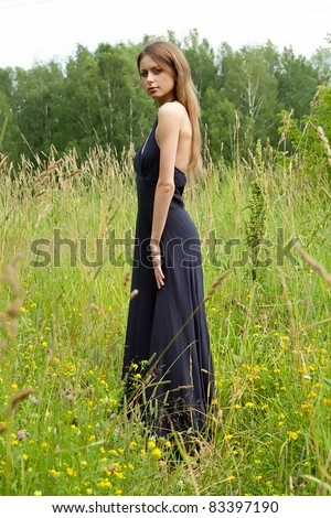 Portrait of the beautiful girl on the nature