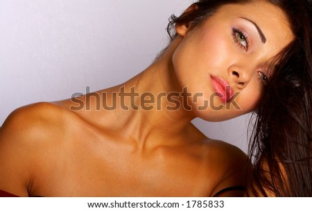 Portrait of the beautiful girl with the naked shoulders
