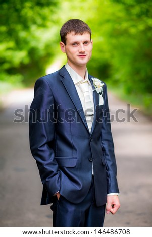 portrait of the beautiful groom on the wedding day