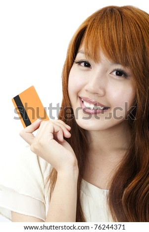 Portrait of the beautiful happy girl  holding  a credit card for shopping