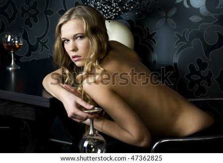 Portrait of the beautiful naked woman with glass