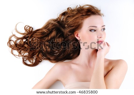Portrait of the beautiful nice woman with red long ringlets hair - stock photo