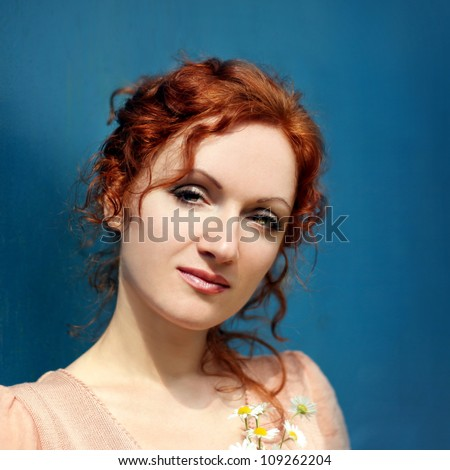 Portrait of the beautiful redheired woman